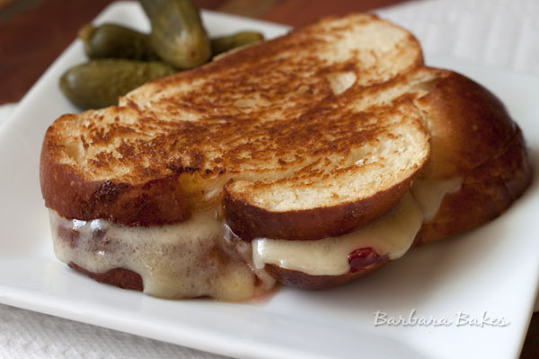 Grilled buttery Challah bread dripping with hot, melty white cheddar cheese and luscious raspberry pepper preserves. A sweet and spicy, ooey, gooey heavenly combination.