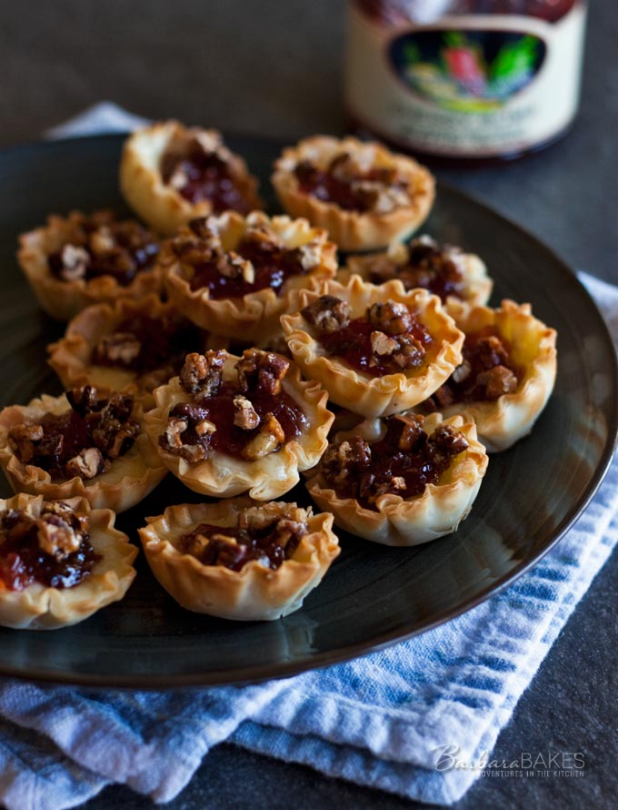 Baked Cherry Jalapeno Brie Bites - A crunchy, creamy, salty, sweet, bite-sized appetizer kicked up a notch with a little cherry jalapeno jelly.