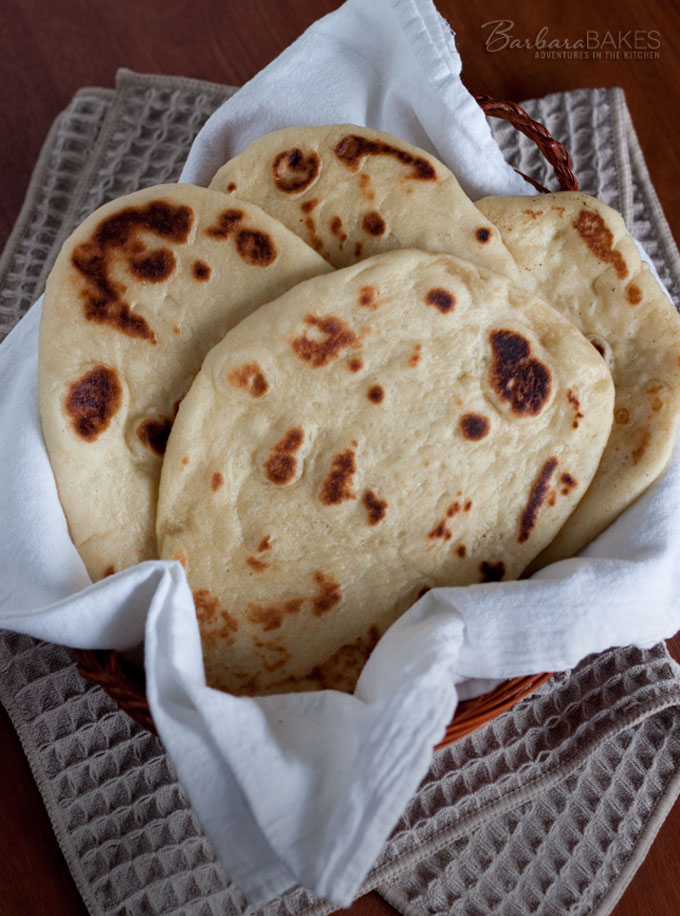 Naan, Indian Flatbread that is ready to eat, fresh and hot from the oven in about an hour using quick rise yeast and a mixer to do the kneading for you.