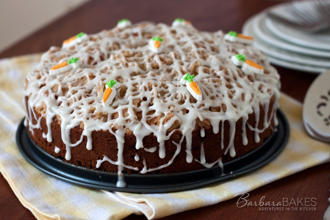 A delightful, moist, tender streusel topped coffee cake filled with carrots and raisins and dripping with a rich cream cheese glaze.