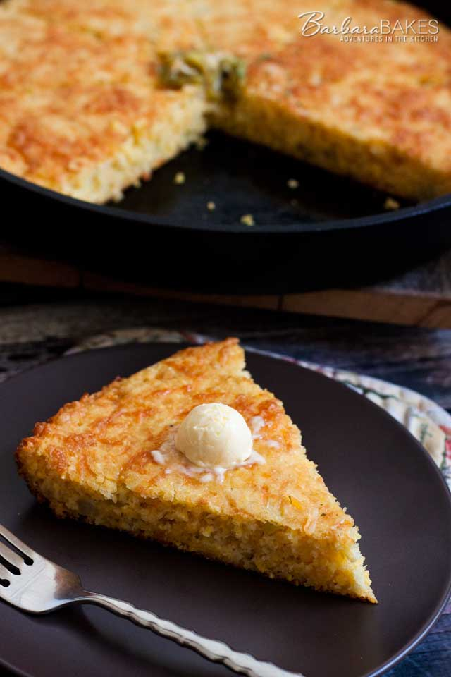 Cheesy Green Chile Cornbread baked in a hot cast iron skillet gives it a golden brown crisp crust.
