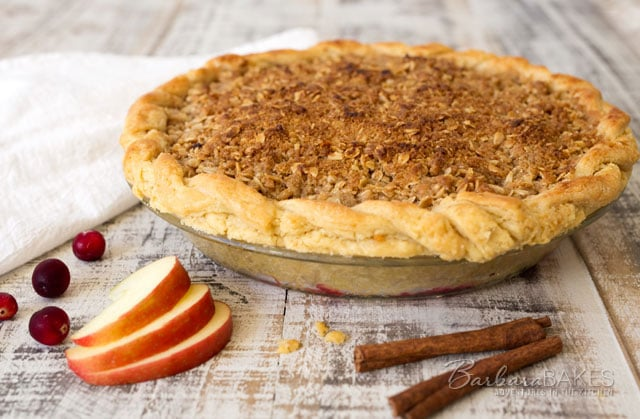 A mouth watering combination of sweet apples and tart cranberries topped with a sweet crumbly streusel topping creates the perfect Thanksgiving pie.