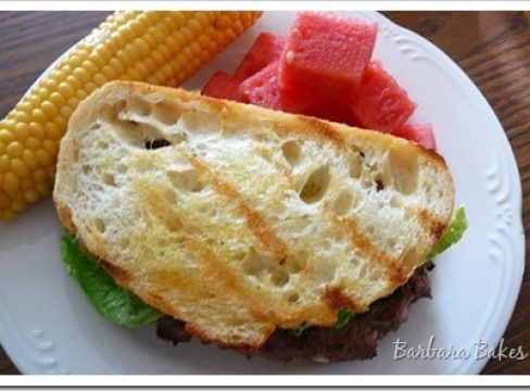 Featured Image for post Caesar Salad Flank Steak Burgers with Garlic Crostini