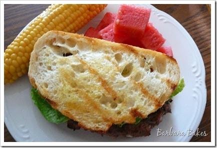 Caesar Salad Flank Steak Burgers with Garlic Crostini