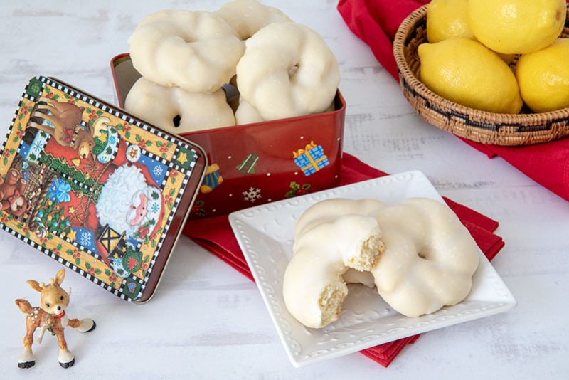 Lemon Glazed Christmas Wreath Cookies in a Christmas tin