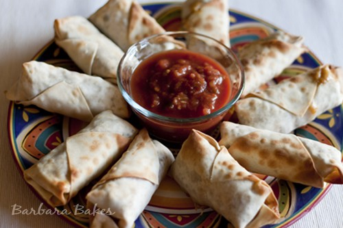 Baked Southwestern Egg Rolls– chicken, black beans, corn, cheese, green chilies, and spices wrapped in a thin egg roll wrapper and baked until they're crispy.