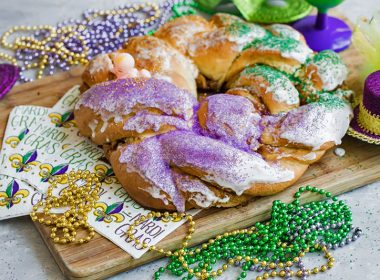 Mardis Gras King Cake with beads and Mardi Gras Napkins