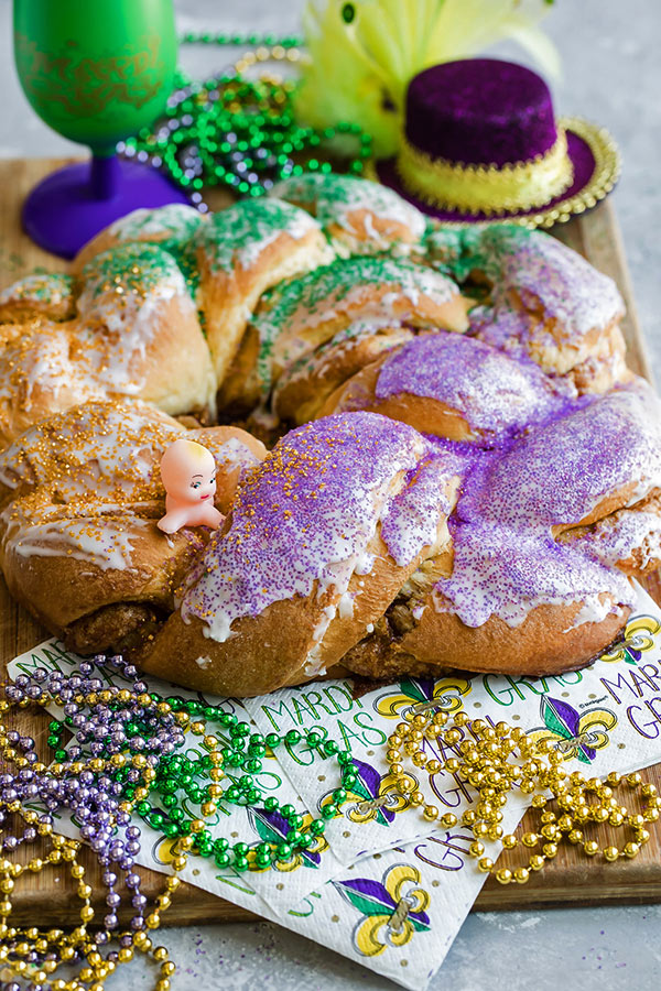 Mardi Gras King Cake with gold, green and purple beads