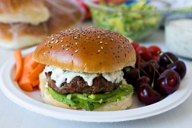 These Queso Bacon Burgers are loaded with bacon and two kinds of peppers sandwiched between a layer of avocado salsa on the bottom and a creamy, spciy queso sauce on top!