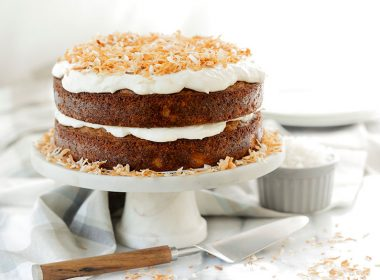 Two layer Tropical Carrot Cake with Coconut Cream Cheese frosting on a cake stand