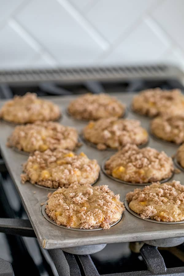 Fresh, ripe, juicy peaches baked in a tender cinnamon muffin crowned with a streusel topping. If you love peaches, you'll love these Peach Cobbler Muffins!