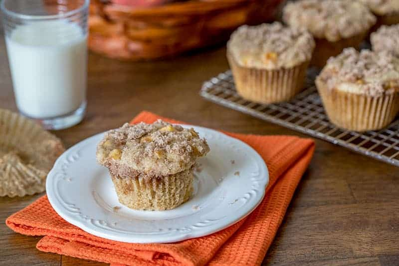 The flavors of peach cobbler in a muffin. If you love peaches, you'll love these Peach Cobbler Muffins!