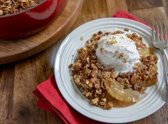 Apple Crisp on a Plate with a Scoop of Vanilla Ice Cream