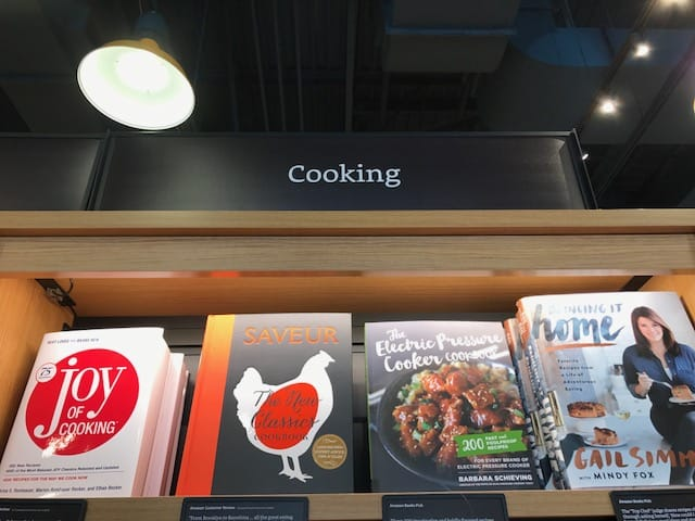 My new pressure cookbook, The Electric Pressure Cooker Cookbook shown above on the same shelf as the Joy of Cooking!