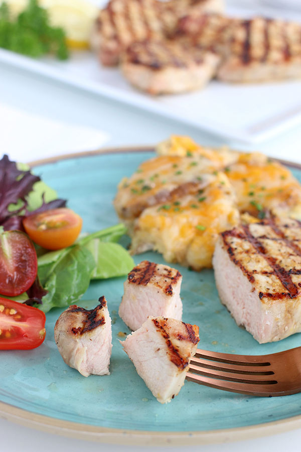 Easy Grilled Lemon Pepper Pork Chops on a fork