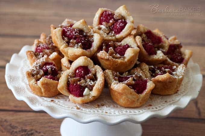 Raspberry White Chocolate Rugelach Bites sprinkled with powdered sugar