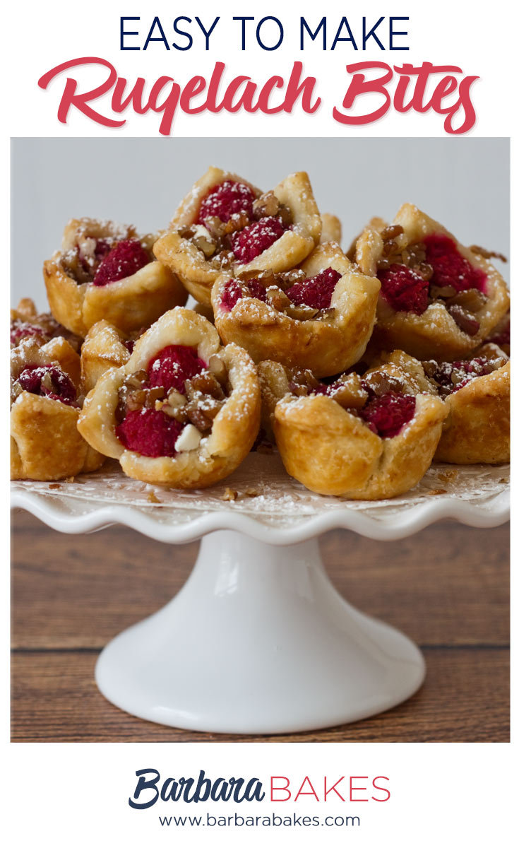 Raspberry White Chocolate Rugelach Bites on a pedestal.
