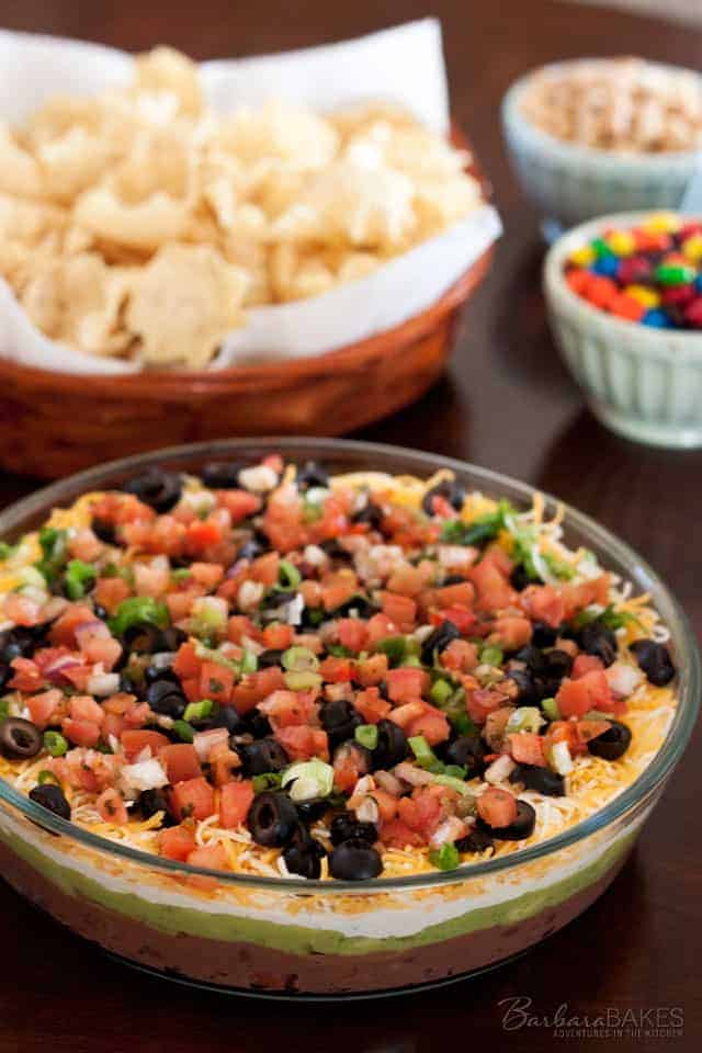 classic 7 layer bean dip made by layering refried beans, creamy ...