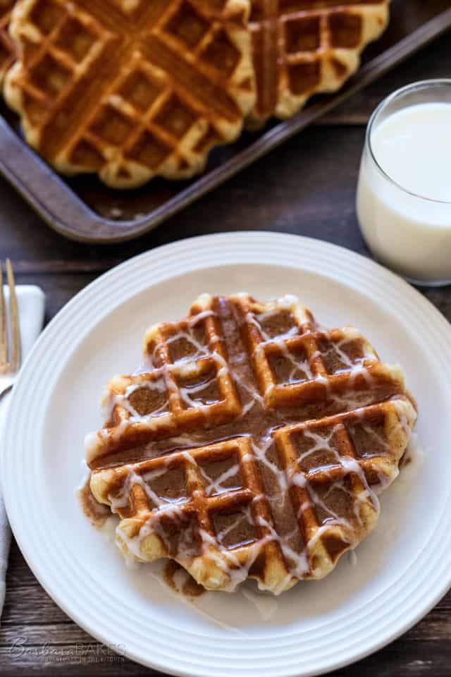 Liege Waffles served cinnamon roll style with a sweet cinnamon butter and a pretty icing drizzle