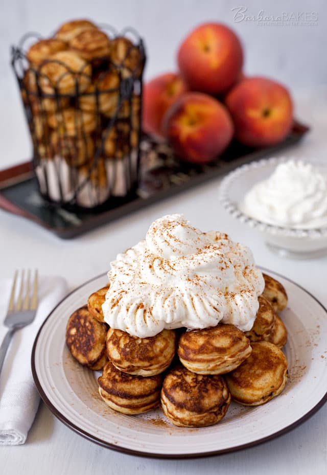 Start your day off with these not-too-sweet, light and fluffy Danish pancakes filled with ripe, juicy peaches topped with lightly sweetened whipped cream.
