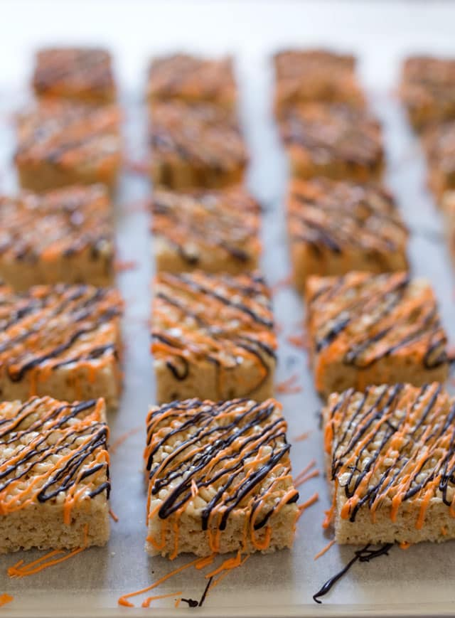 crispy treats dressed up with a drizzle of orange and black candy melts are the perfect