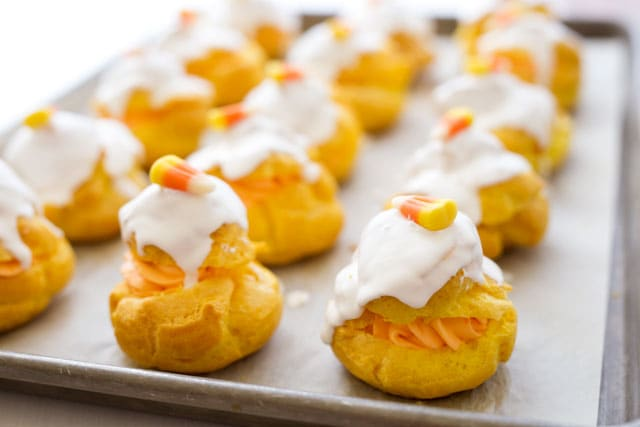 These fun Candy Corn Cream Puffs start with a bright yellow cream puff ...