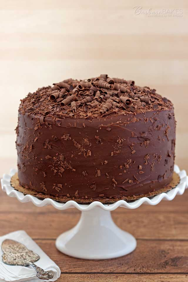 How to do a crumb coat on a layer cake.