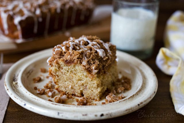 A moist buttermilk banana cake topped with a sweet, buttery crumb topping, drizzled with a simple vanilla glaze. A craveable cake your family will love.