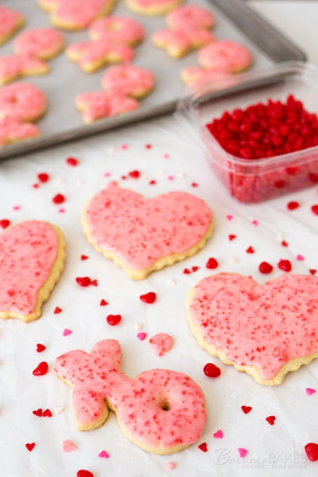 Spice up this year's Valentine sugar cookies with cinnamon. These fun Red Hot Sugar Cookies start with a tender sugar cookie base that's iced with a cinnamon frosting loaded with crushed Red Hot candies.
