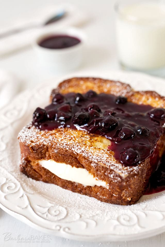 A decadent, heavenly delicious French toast filled with a light, lemony cream cheese filling. It's made with a fabulous brioche bread and served with a sweet, tart blueberry compote.
