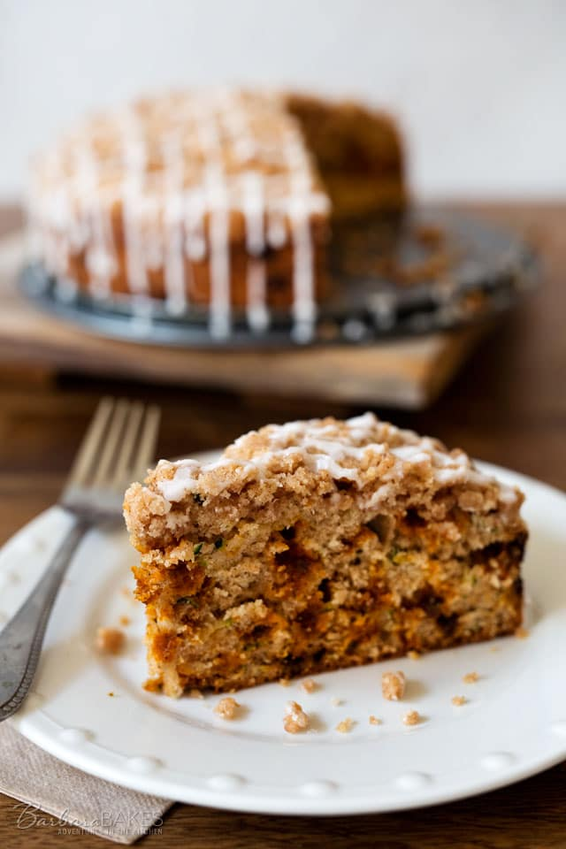 A tender, moist Cinnamon Zucchini Streusel Coffee Cake loaded with good for you zucchini and spicy cinnamon chips. It's crowned with a sweet, crumbly streusel topping and finished with a pretty glaze.