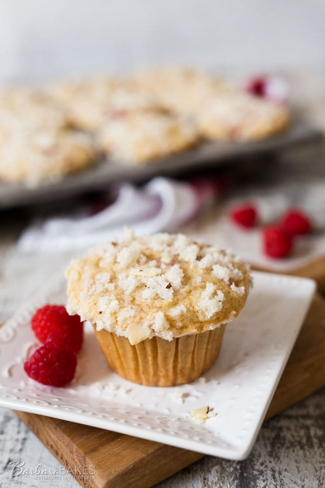 Big, fluffy, moist, tender Raspberry Banana Streusel Muffins loaded with raspberries and topped with a sweet, crunch almond streusel topping.