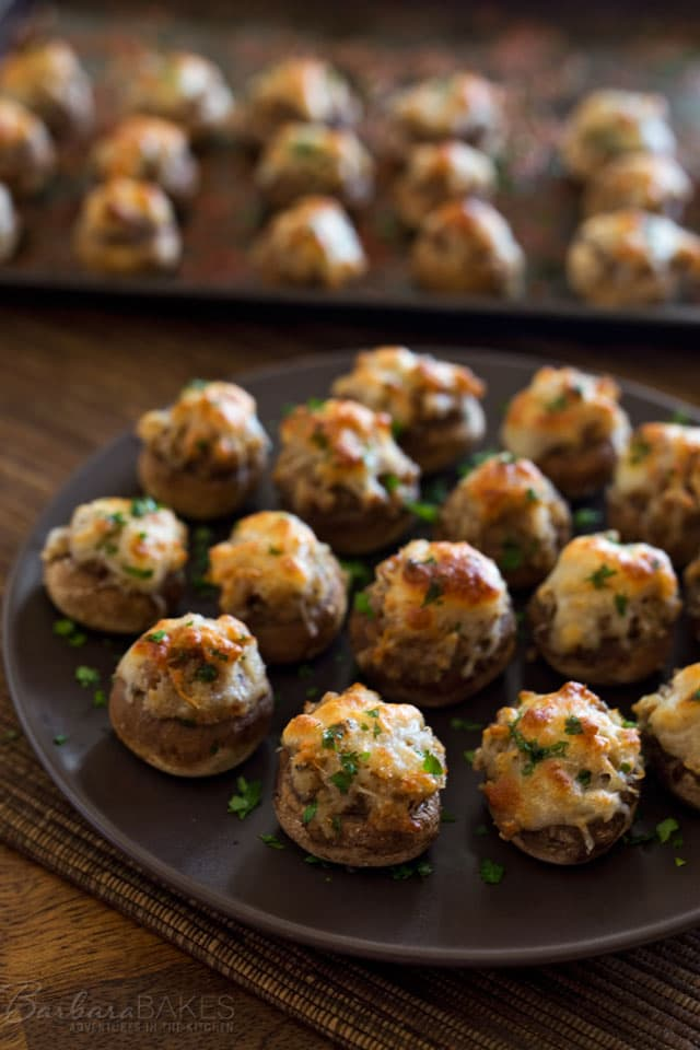 These 6 Cheese Italian Sausage Stuffed Mushrooms are a perfect addition to your next holiday party. Button mushrooms stuffed with sausage and 6 Cheese Italian finely shredded cheese, then baked until they're tender and golden brown.