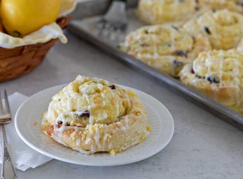 Cranberry Citrus Cream Cheese Sweet Rolls made with a buttery yeast dough filled with citrus sugar, cranberries, topped with an orange cream cheese filling.