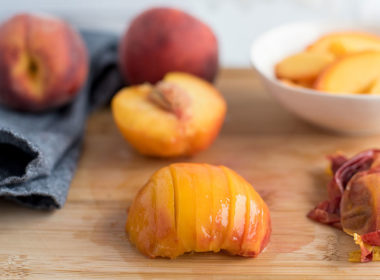 Peaches in various stages of slicing