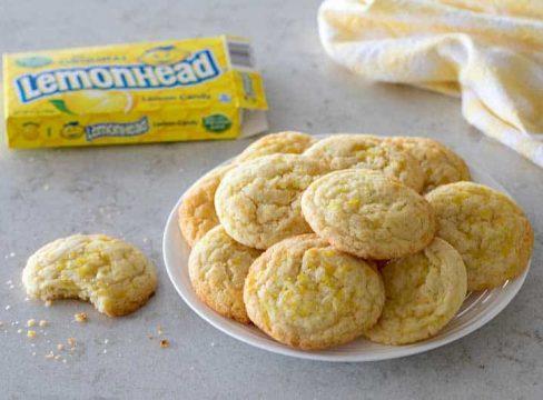Lemon Doodle Cookies rolled in yellow sugar and crushed Lemonhead candies.
