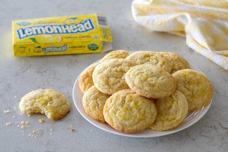 A fun twist on a Snickerdoodle Cookie, these Lemon Doodle Cookies are a soft lemon cookie rolled in crushed Lemonhead candies.