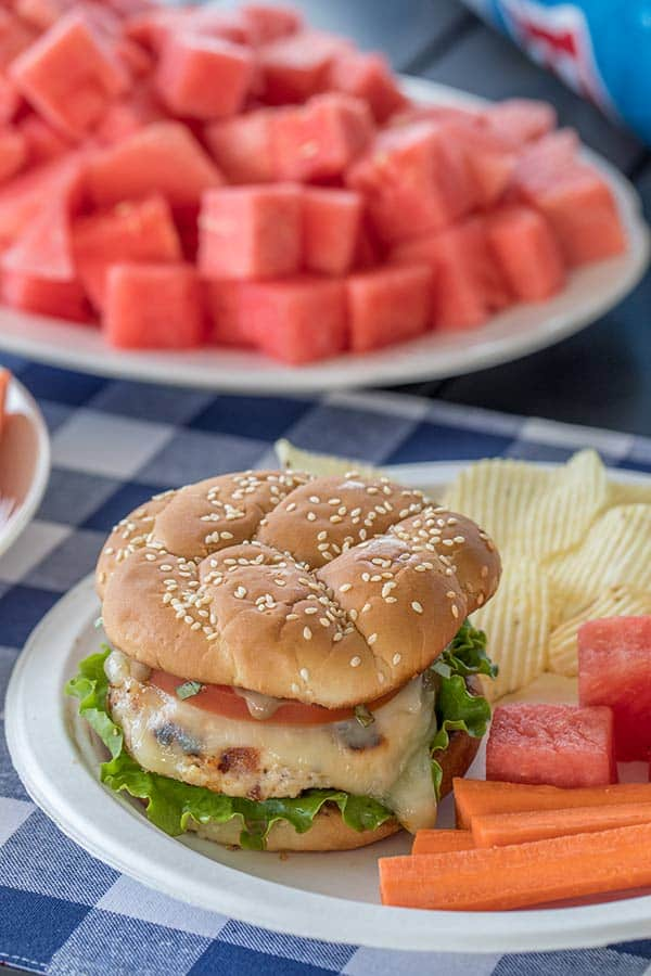 These Chicken Caprese Burgers are the new favorite burger at our house. A grilled chicken burger topped with melty mozzarella, tomato, basil and a flavorful balsamic mayo. It's a must try burger this summer.