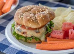 A grilled chicken burger topped with melty mozzarella, tomato, basil and a flavorful balsamic mayo. It's a must try burger this summer.