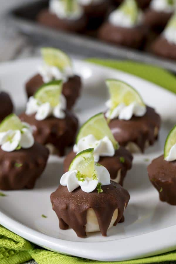 Luscious Chocolate Covered Frozen Key Lime Pie Bites are perfect for summertime entertaining. They're easy-to-make, no-bake, and require only a few minutes of hands on prep time.
