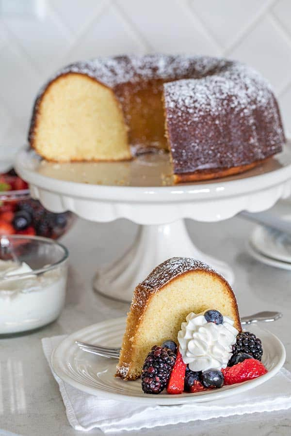 A Classic Vanilla Bundt Cake - moist and tender on the inside with a sweet sugar glaze on the outside.