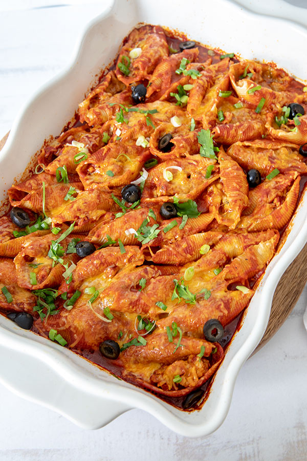 Jumbo pasta shells stuffed with sausage and covered in enchilada sauce and cheese
