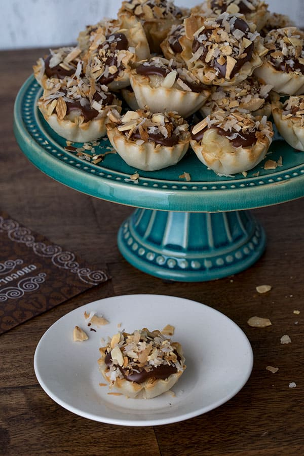 Not only are these Chocolate Almond Coconut Pie Bites easy-to-make, they're easy for your guests to eat, and easy for you to serve.