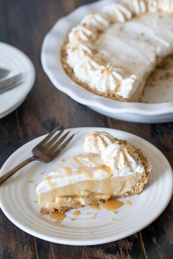 Brown Sugar Banana Cream Pie served with a drizzle of caramel ice cream topping.