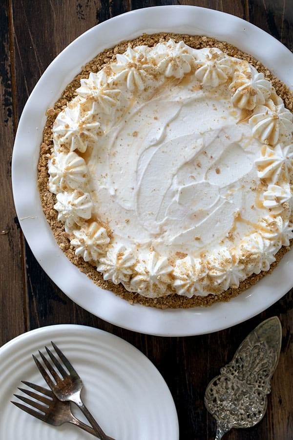 Brown Sugar Banana Cream Pie with a graham cracker crust layered with bananas, luscious brown sugar custard and whipped cream.