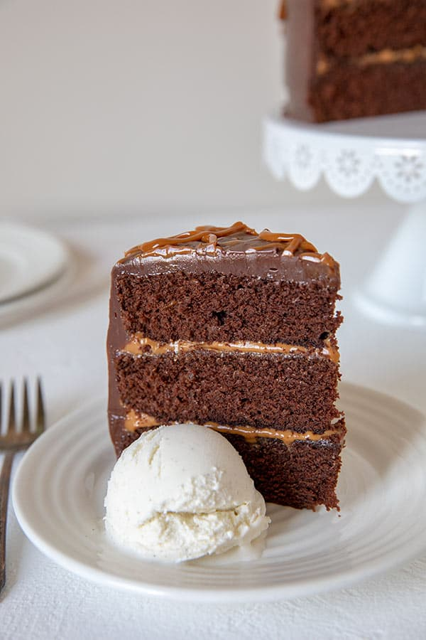 This rich, delicious, and easy-to-make Chocolate Dulce De Leche Triple Layer Cake is perfect any night of the week or for a special occasion.