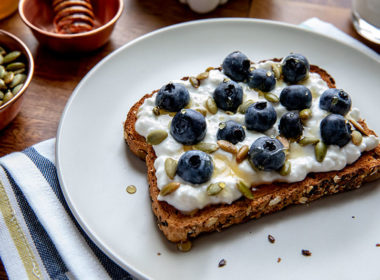 Protein Toast with Cottage Cheese, Pumpkin Seeds, Blueberries and a Drizzle of Honey