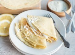 Three Crepes With Lemon Ricotta Filling on a plate
