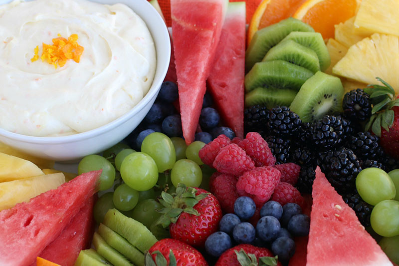 Creamy Orange Fruit Dip in a bowl with fruit