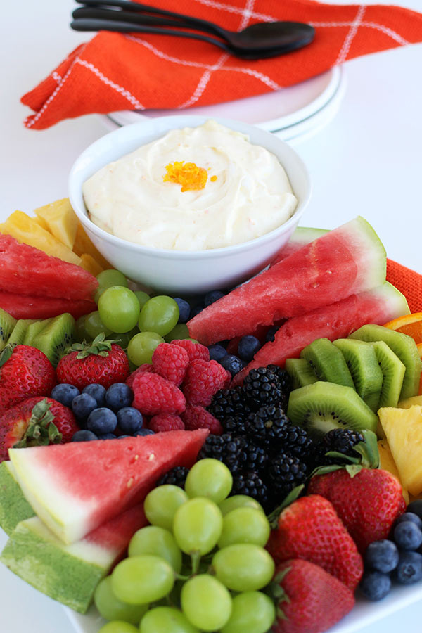 Creamy Orange Fruit Dip in a bowl with assorted fruit